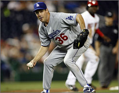 Greg Maddux, who added to his record with his 18th Gold Glove award on Thursday, is pondering retirement and may not boost his impressive career numbers, which include 355 wins, next season.