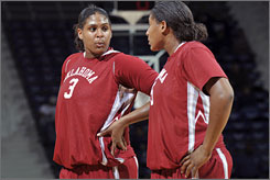 Courtney Paris, left, and her sister Ashley combined for nearly 30 points per game for Oklahoma last season.