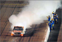 NASCAR  Craftsman Truck Series driver Kevin Harvick celebrates alongside his crew after winning the Lucas Oil 150 at Phoenix International Raceway in Avondale, Ariz. The win was Harvick's first in the truck series in five years.