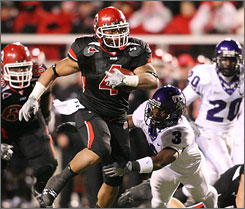 Utah's Matt Asiata gains some extra yards against TCU's defense during the ninth-ranked Utes' come-from-behind victory over the Horned Frogs on Thursday night.