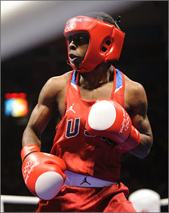 Former Olympic gold medalist USA Rau'shee Warren, of the USA, boxes during a flyweight (112 pounds, 51kg) preliminary bout at the Workers' Gymnasium at the Beijing Olympics.