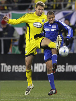 The Columbus Crew's Chad Marshall, left, and the Kansas City Wizards' Abe Thompson fight for a loose ball during the first half of their MLS playoff game in Columbus. The Crew won 2-0 to advance to the Eastern Conference Finals.