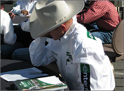 Bull rider Cord McCoy of Tupelo, Okla., studies the list of bulls before picking his ride for Saturday night at the PBR World Finals. McCoy chose Splatter with the 30th pick.