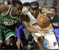 Celtics center Kendrick Perkins reaches to strip the ball from Pistons guard Allen Iverson during the second half.