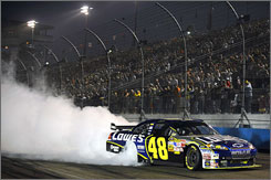 Jimmie Johnson smokes his tires on the frontstretch after securing his seventh victory of 2008 at Phoenix International Raceway.