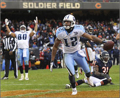 Titans receiver Justin Gage, right, caught one of two touchdown passes from QB Kerry Collins in Chicago.