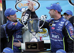 Jimmie Johnson, left, gets a high-five from crew chief Chad Knaus after winning the NASCAR Sprint Cup SeriesTums QuikPak 500 race at Martinsville (Va.) Speedway on Oct. 19. The pair, together since Johnson's rookie year in 2002, will become the longest-running driver-crew chief tandem in the Cup Series.