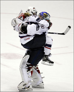 Team USA goalie Jessie Vetter hugs teammate Natalie Darwitz at the conclusion of the team's shootout win over Canada in the finals of the Four Nations Cup.