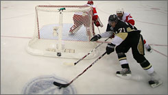 Evegeni Malkin and the Penguins, here in Game 6 of the 2008 Stanely Cup Finals, will try to get revenge in Detroit Tuesday night.