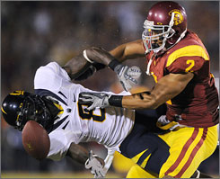 Southern California safety Taylor Mays, the Pac-10 defensive player of the week, hits California's Nyan Boateng during their game last Saturday.
