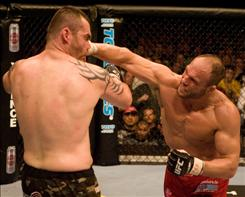 Randy Couture, punching Tim Sylvia in a 2007 bout, defends his title against Brock Lesnar on Saturday.