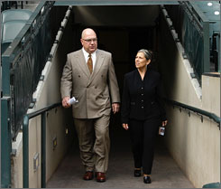 Jack Zduriencik, left, and wife Debbie walk out onto Safeco Field after Zduriencik was introduced as the Mariners' new general manager Oct. 24.