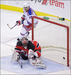 The Rangers' Nigel Dawes looks as teammate Lauri Korpikoski's shot gets past Devils goalie Kevin Weekes for a goal in New York's 5-2 triumph.