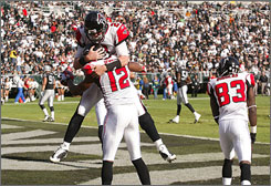 Matt Ryan, celebrating a touchdown pass to Michael Jenkins on Nov. 2, has 11 scoring passes and just five interceptions while leading the Falcons to a 6-3 start.