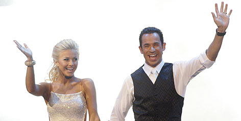 In much happier times: Indy Racing League driver Helio Castroneves and Julianne Hough won 2007's 'Dancing with the Stars.' Castroneves and Penske Racing have asked for a postponement in his tax trial so he can compete on the track this year.