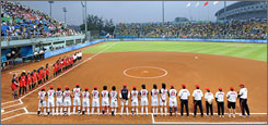 The American and Japanese teams gather on the baselines before what may have been the final softball game in Olympic history.