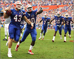 Florida's James Smith and teammates celebrates after recovering a fumble in the first half against South Carolina.
