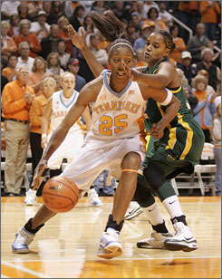 Tennessee freshman Glory Johnson, driving against San Francisco's Vania Singletary during the first half, paced the Lady Vols' win with 17 points and 12 rebounds.