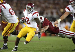 Southern Cal's C.J. Gable, evading a Stanford defender in the second half, scored twice to help the Trojans leave Stanford with a victory.