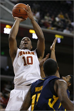 Southern Cal's DeMar DeRozan, shooting over a UC Irvine player in the first half, scored 14 points in his winning debut with the No. 21 Trojans.