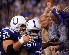 Colts center Jeff Saturday, left, celebrates a touchdown with Joseph Addai in the second half.