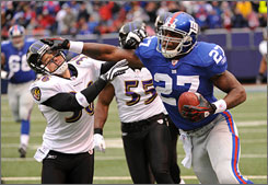 Brandon Jacobs set the tone for a Giants running game that rushed for 207 yards against the Ravens' top-rated rushing defense.