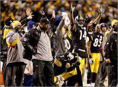 The Steelers sideline reacts to Jeff Reed's field goal going through the uprights with the winning points against San Diego.