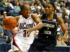Connecticut's Lorin Dixon drives against Georgia Tech's Jacqua Williams.