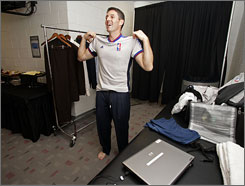 Scott Foster suits up in the officials' dressing room before a Sixers-Heat matchup Nov. 5.