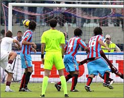 Catania's forward Gianvito Plasmati, right, is seen with his shorts down as his teammate Giuseppe Mascara, not pictured, scores a goal.