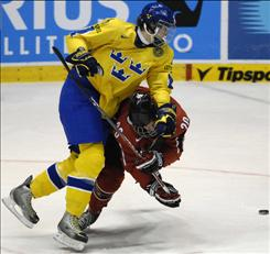 Sweden's Victor Hedman, left, wraps up another likely first-round draft pick, John Tavares of Canada.