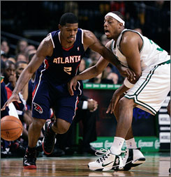 The Atlanta Hawks' Joe Johnson, left, may not be a household name but there's no arguing the shooting guard's importance to the team.