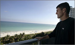 Scott Foster takes a brief timeout for himself on the balcony of a Miami hotel before a working a game that night.