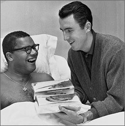After Maurice Stokes, left, suffered a disabling injury that cut short his NBA career in the late 1950s, Cincinnati Royals teammate Jack Twyman, right, became his guardian.