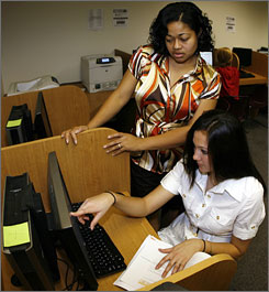 "Louisville associate director of academic services Christine Jackson helps Anastasia Artemeva of Russia, a sophomore volleyball player, in a computer lab at the university. Jackson says advisers let students pick majors and courses while pointing out those which might conflict with practices. ""I like to say I'm the reality check,"" says Jackson."