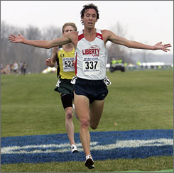 Josh McDougal crosses the finish line to finish first at the 2007 NCAA cross country championships and later credited training parter Sam Chelanga for helping him win. This year, McDougal hopes to help Chelanga claim a national title of his own.