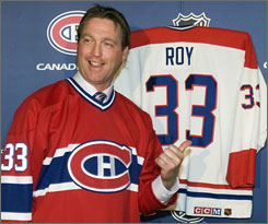 Hall of Fame goalie Patrick Roy shows off his No. 33 jersey which will be retired by the Montreal Canadiens on Saturday. Roy won two Stanley Cups in his time with Montreal.