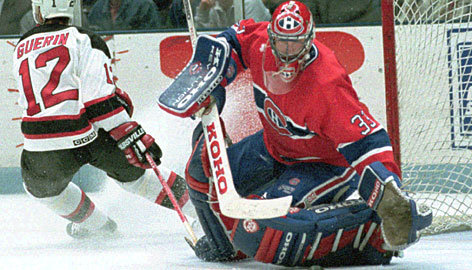 Patrick Roy makes a save against New Jersey's Bill Guerin during a game in 1993. Roy's No. 33 jersey will be retired by the Montreal Canadiens on Saturday.