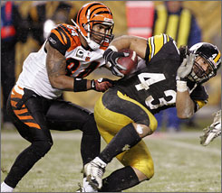 Steelers safety Troy Polamalu, right, is grabbed by Bengals wide receiver T.J. Houshmandzadeh after intercepting a pass in the fourth quarter at Heinz Field in Pittsburgh.