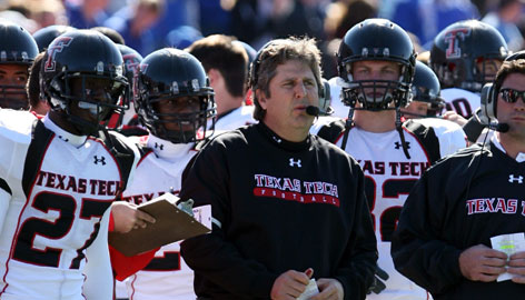 Texas Tech coach Mike Leach, shown during the Red Raiders' win at Kansas on Oct. 25, has used a pass-first offense to turn Tech into a national title contender.