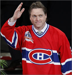 Former Canadiens goalie Patrick Roy acknowledges the Montreal crowd during the pre-game ceremony which saw his No. 33 rise to the rafters. The Boston Bruins ruined the festivities as they left town with a 3-2 shootout victory.