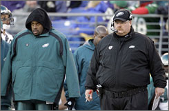 After benching starter Donovan McNabb, left, on Sunday, Eagles coach Andy Reid said he's unsure who will start Thursday night vs. Arizona.