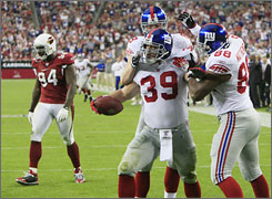 Giants teammates congratulate Madison Hedgecock after his third-quarter touchdown.