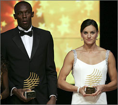 Usain Bolt, left, of Jamaica and Yelena Isinbayeva of Russia show off their IAAF Athlete of the Year awards on Sunday night. Bolt won gold medals in the 100, 200 and 4x100 relays in Beijing while Isinbayeva won the pole vault gold medal.