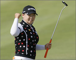 South Korea's Ji-Yai Shin, 20, celebrates after sinking her final putt to capture the ADT Championship by one stroke over Karrie Webb. It was Shin's first victory on American soil and 11th this season.