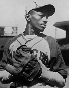 Hall of Fame pitcher Satchel Paige wearing the uniform of the Kansas City Monarchs during his Negro League days.