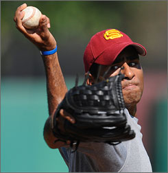 Rinku Singh throws batting practice during a workout earlier this year at USC's baseball field. Singh and Dinesh Patel, both from India, were offered contracts by the Pittsburgh Pirates on Monday.