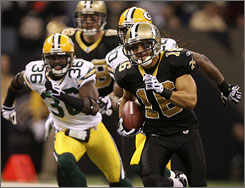 Saints receiver      Lance Moore races to the end zone on a 70-yard touchdown in the half.