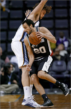 San Antonio Spurs guard Manu Ginobili, right, tries to drive around Memphis Grizzlies center Marc Gasol in the first half of their game in Memphis. Ginobili returned to the Spurs' lineup for the first time this season after surgery on his left ankle.
