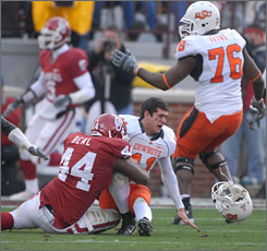 Oklahoma will have to slow down Oklahoma State's Zac Robinson if it wants to stay alive in the Big 12 title hunt.